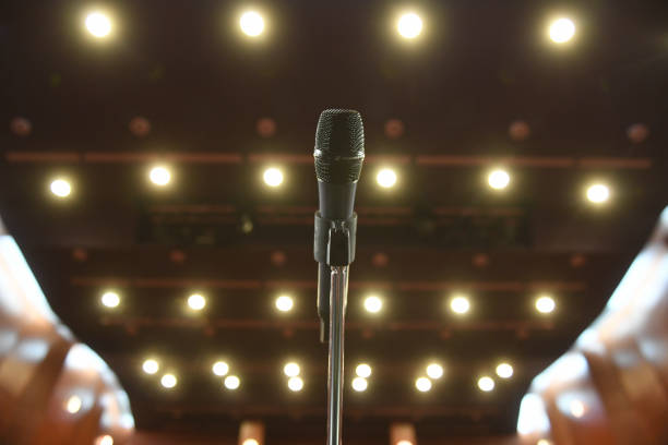 Microphone in front of an empty theatre hall stock photo
