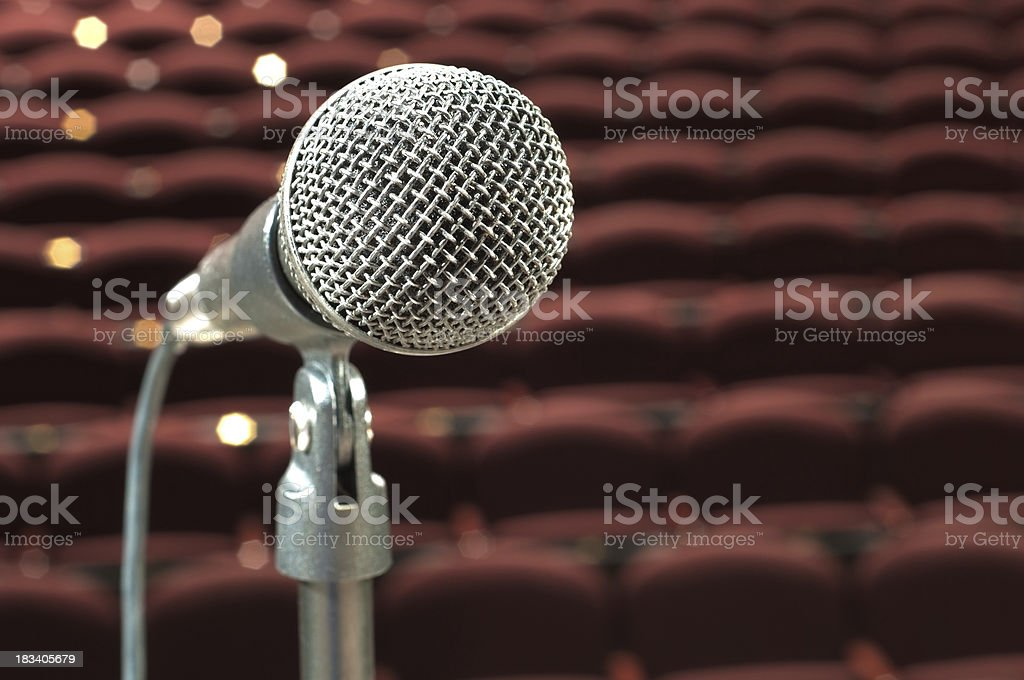 microphone in front of auditorium stock photo