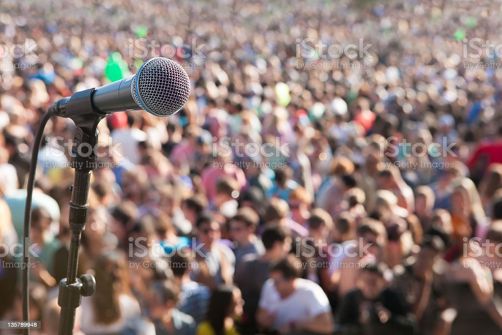Microphone in front of crowd royalty-free stock photo