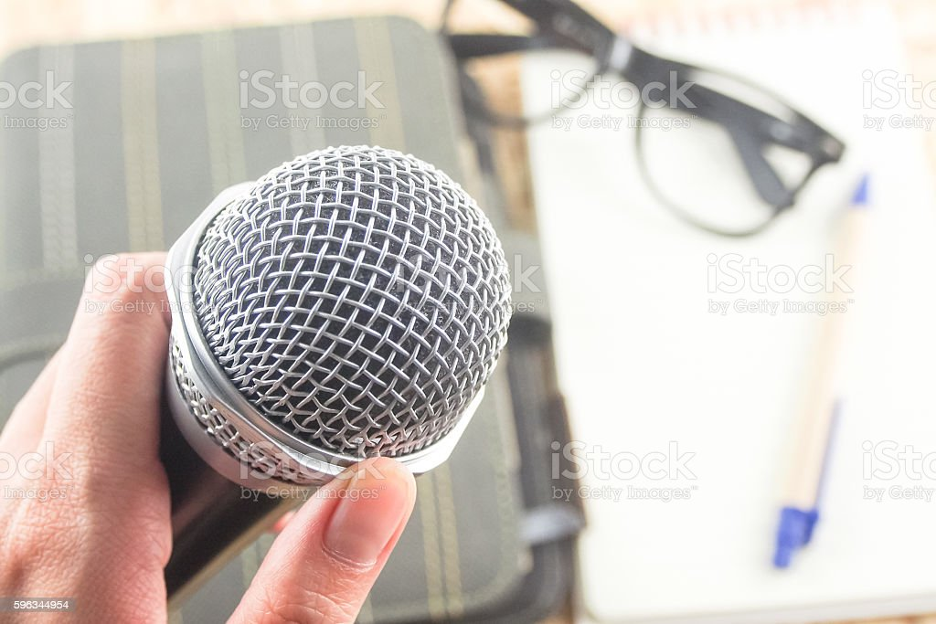 microphone in hand conference room royalty-free stock photo