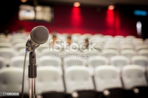 491577806 istock photo Microphone in Modern Lecture Hall 174980658