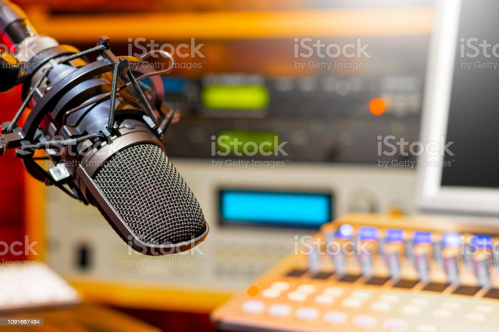 microphone in radio broadcasting, podcast, voice acting studio