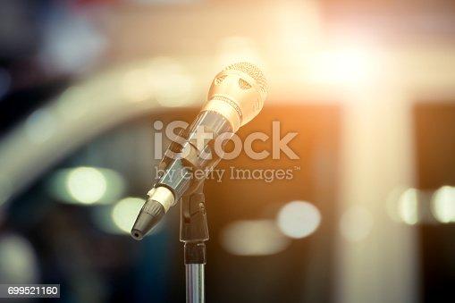 istock Microphone in seminar event defocus on background 699521160