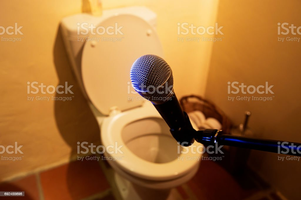 Microphone in the bathroom at toilet stock photo