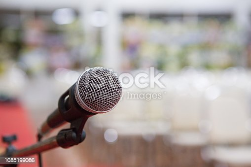 671733994 istock photo microphone in the seminar room blurred background 1085199086