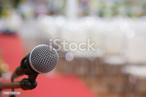 671733994 istock photo microphone in the seminar room blurred background 1085199100