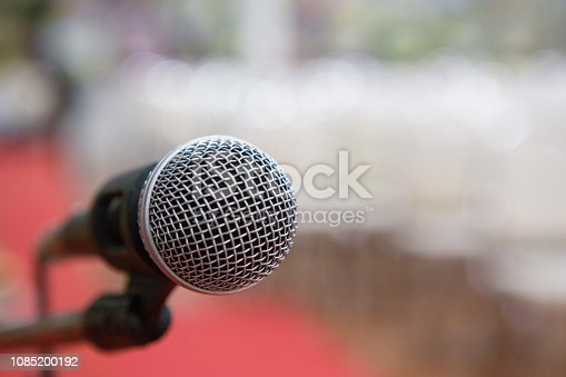 671733994 istock photo microphone in the seminar room blurred background 1085200192
