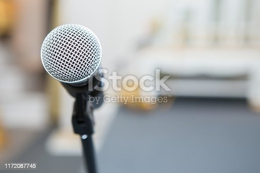 671733994 istock photo microphone in the seminar room on blurred background 1172087745