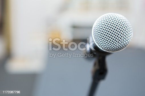 671733994 istock photo microphone in the seminar room on blurred background 1172087796