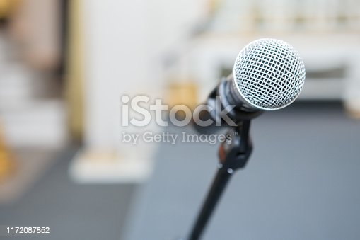 671733994 istock photo microphone in the seminar room on blurred background 1172087852