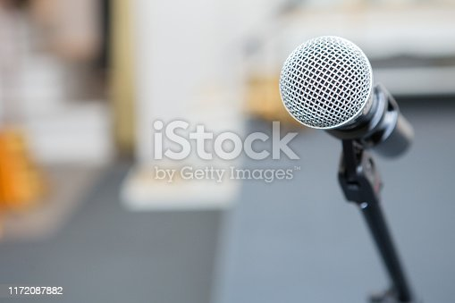 671733994 istock photo microphone in the seminar room on blurred background 1172087882