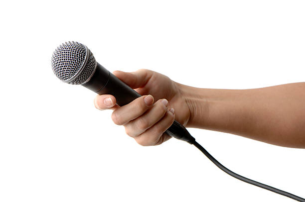Microphone in Woman's Hand stock photo