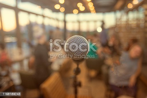 478810450 istock photo Microphone infront of defocused audience 1168189243