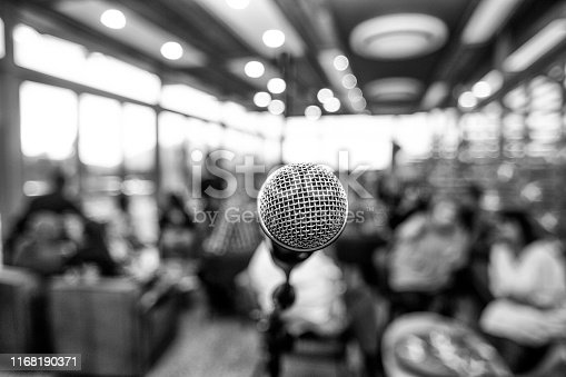 478810450 istock photo Microphone infront of defocused audience 1168190371