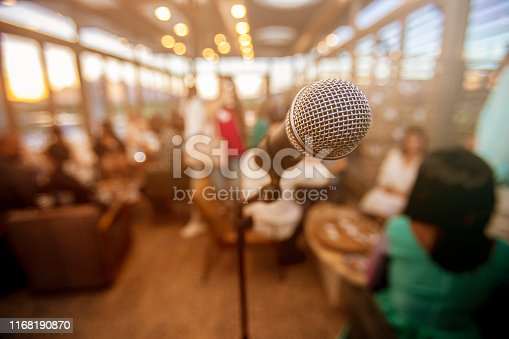 478810450 istock photo Microphone infront of defocused audience 1168190870