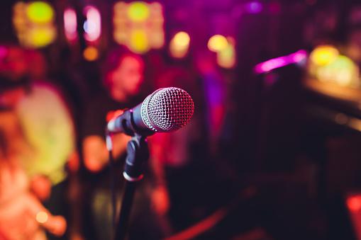istock Microphone. Microphone close-up. A pub. Bar. A restaurant. Classical music. Music. 1179435850