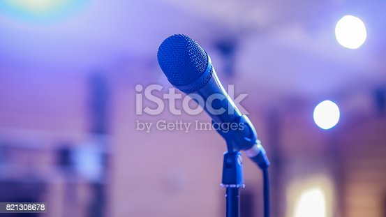 istock Microphone. Microphone on stage. Microphone close-up. A pub. Bar. A restaurant. Classical music. Music 821308678