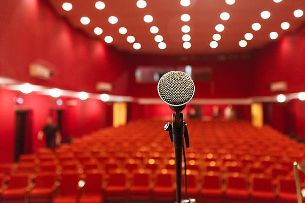 microphone on a background of red hall with seating for stock photo