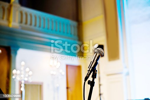 478117515 istock photo Microphone On A Stage 1008429986