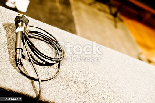 istock Microphone On A Stage 1008430026