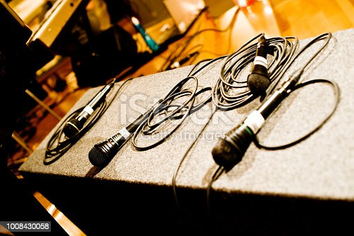 478117515 istock photo Microphone On A Stage 1008430058
