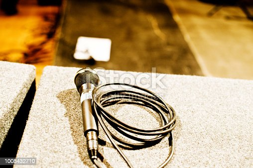 478117515 istock photo Microphone On A Stage 1008432710