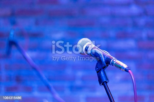Microphone on a stage waiting for a singer to come to stage and perform
