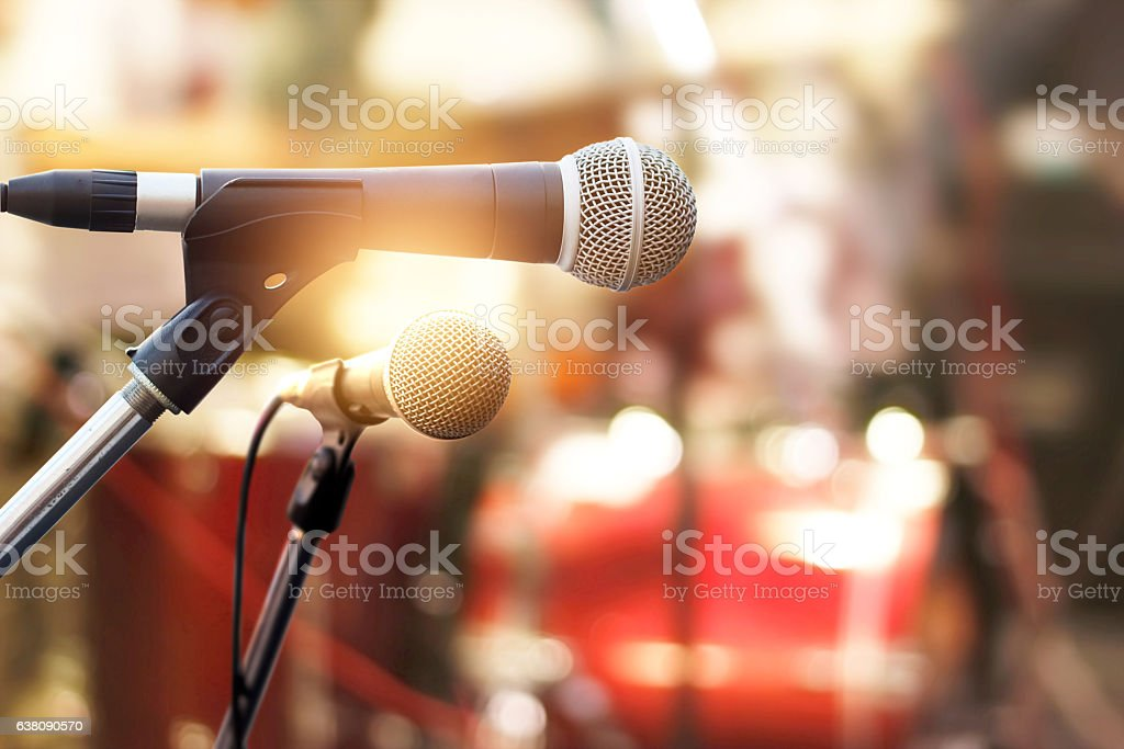 Microphone on concert stage background stock photo