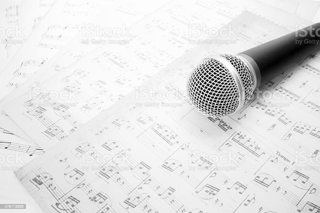 microphone on music sheet stock photo