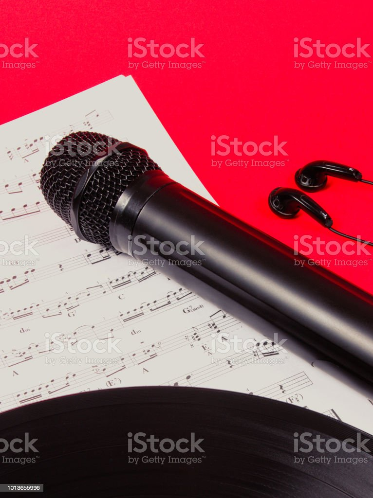 The concept of creating music. Microphone on music sheets. Music...