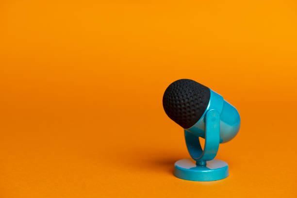 Microphone on orange background. stock photo