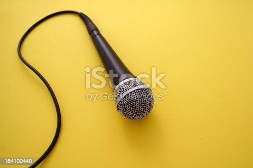 istock Microphone on orange background 184100440