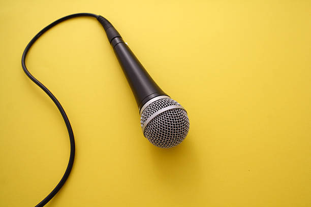 Microphone on orange background stock photo