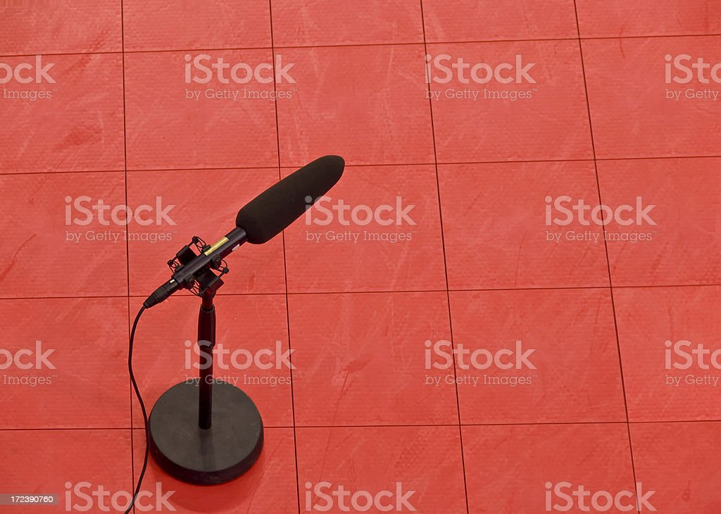 Microphone on Red Tiled Floor royalty-free stock photo