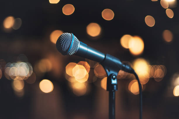 Microphone on stage against a background concert or show stock photo