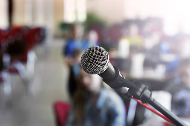Microphone on stage against a background of auditorium stock photo