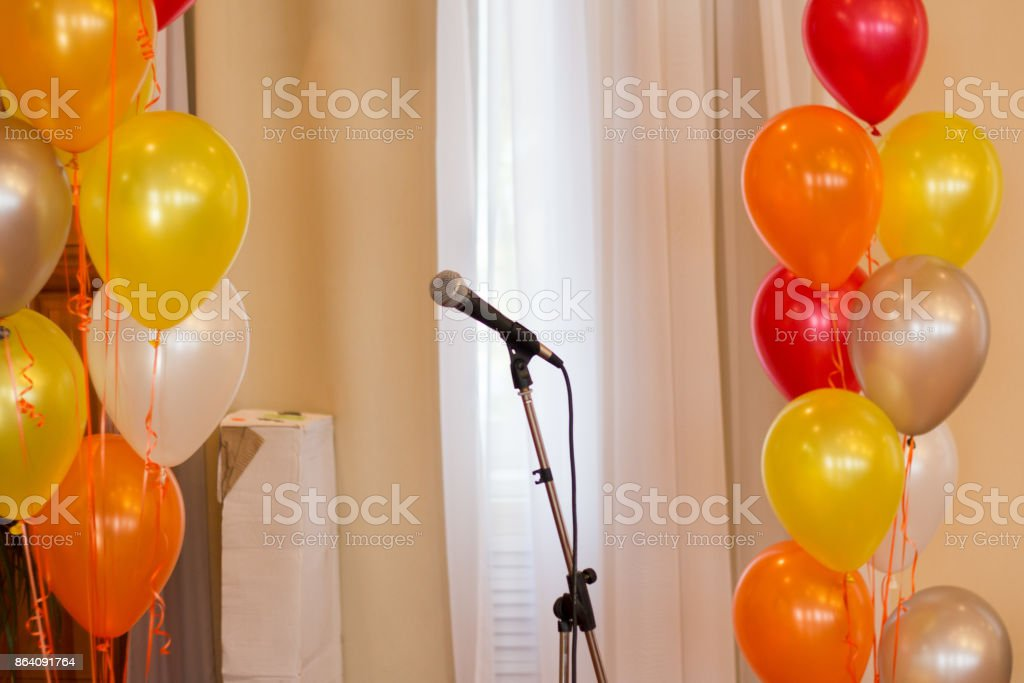 Microphone on stage against a background of auditorium . royalty-free stock photo