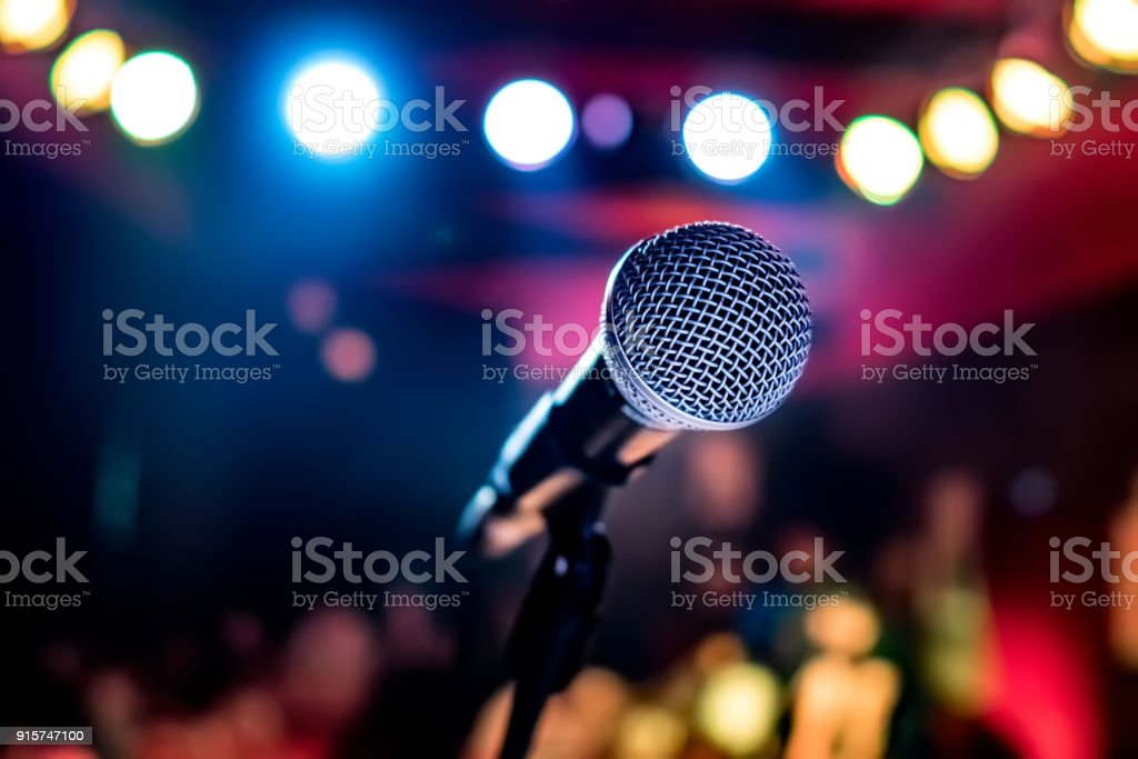 Microphone on stage against a background of auditorium. stock photo