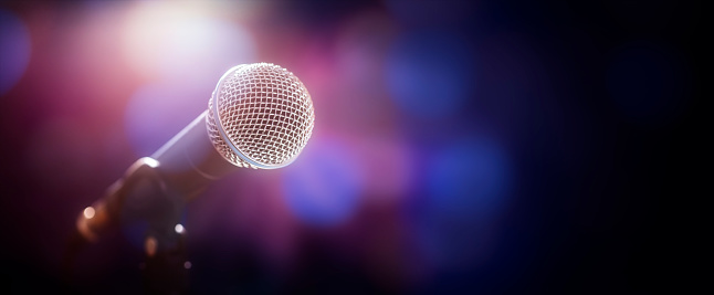 Microphone on stage at concert or event background