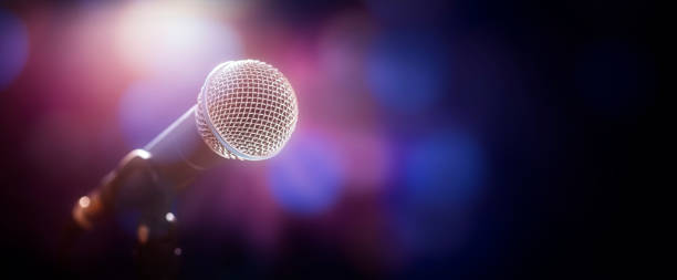 Microphone on stage at concert or event background stock photo