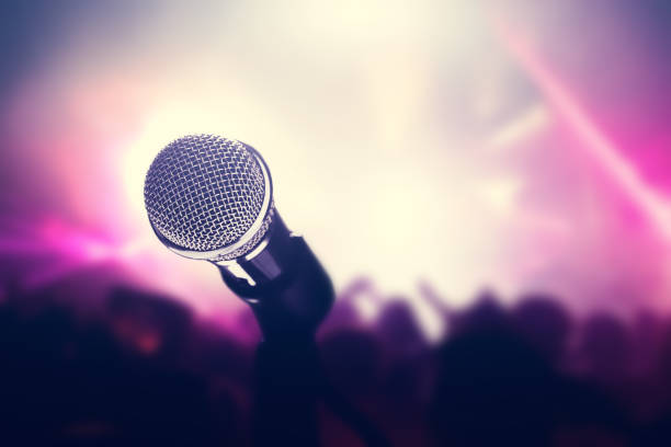 microphone on stage, crowd of people in the club. - audition stock photos and pictures