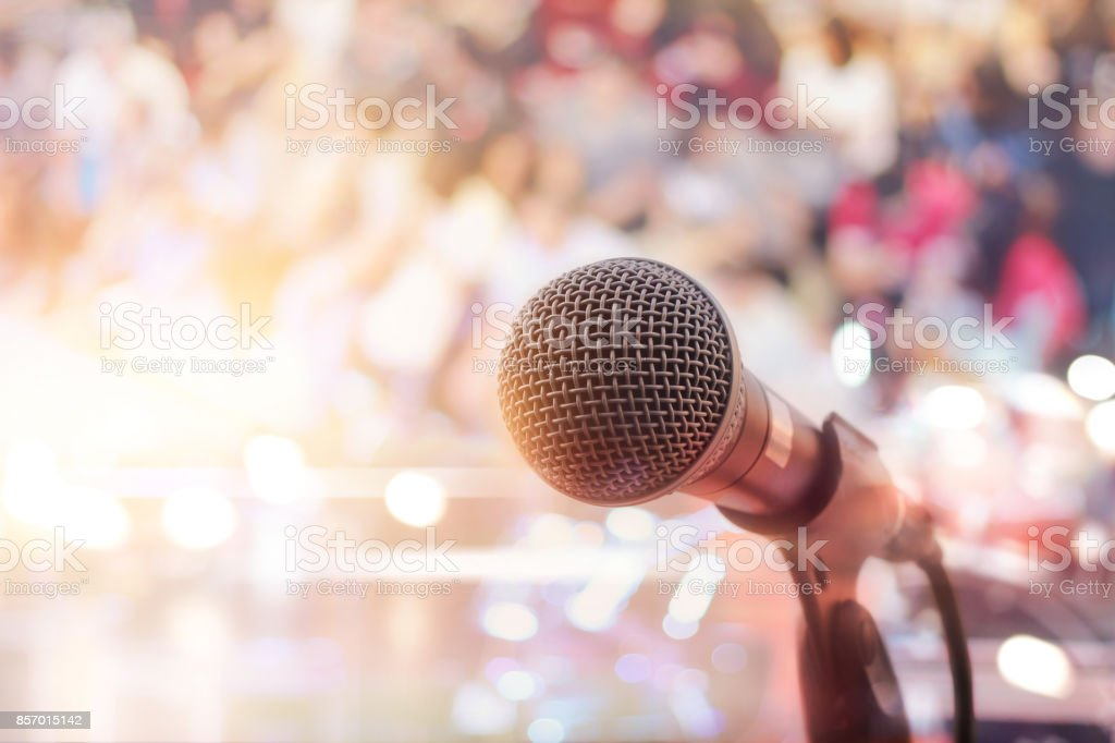 Microphone on stage in concert with people background stock photo