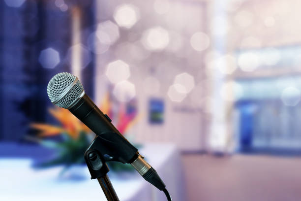 Microphone on stage in conference hall stock photo