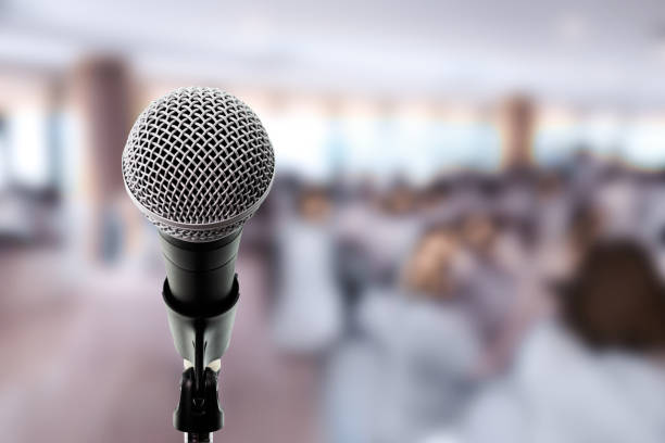 Microphone on stage in conference hall. stock photo
