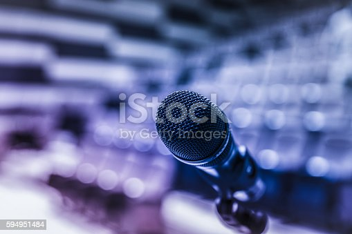 istock Microphone on stage 594951484
