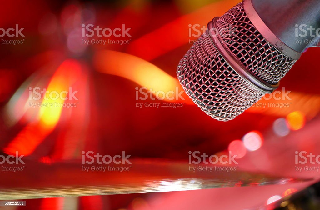Microphone on stage red background close up stock photo