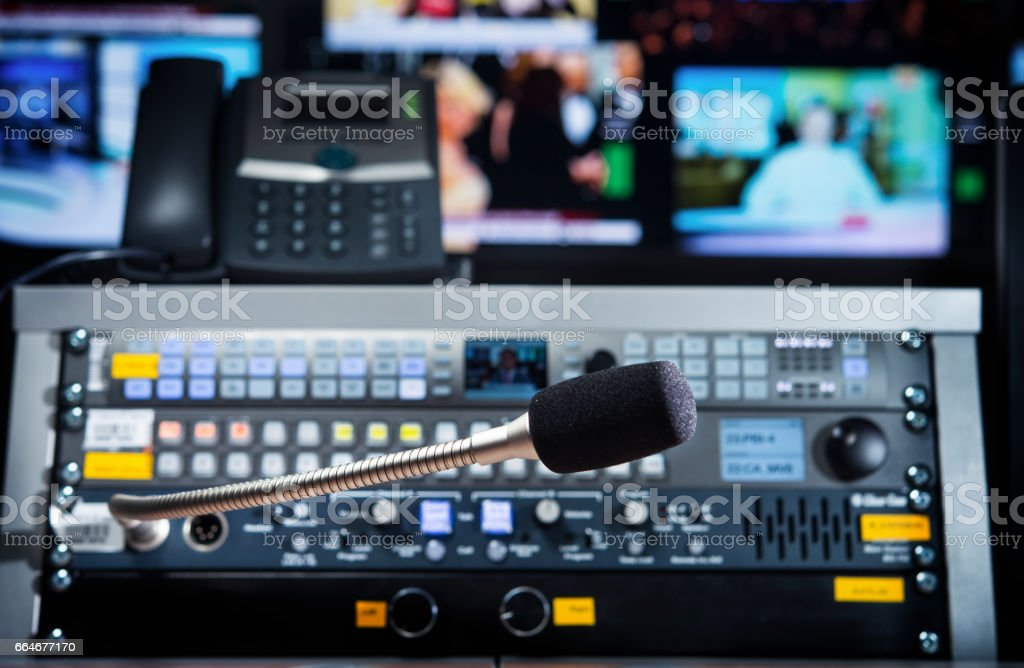 microphone on the control panel in the media studio stock photo