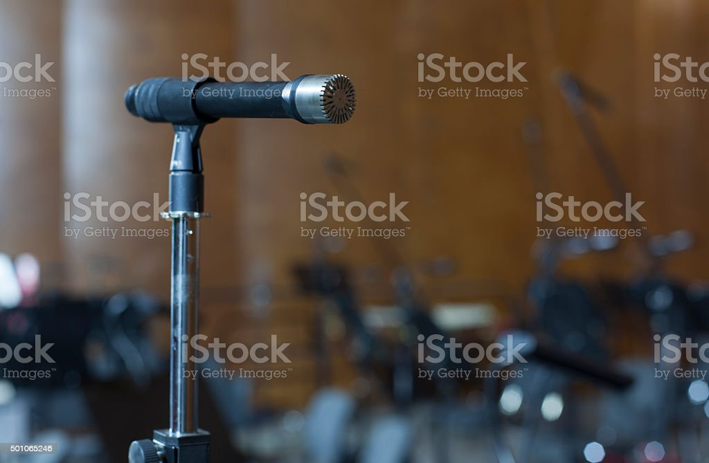 microphone on the stage and empty hall during the rehearsal stock photo