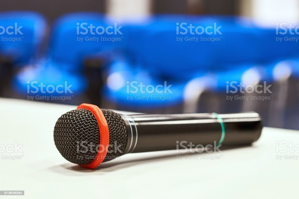 Black microphone on the table in empty auditorium