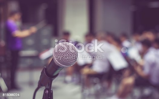 671733994 istock photo Microphone over the Abstract blurred photo of classic music band when rehearsal, musical concep, seminar meeting concept 815088224